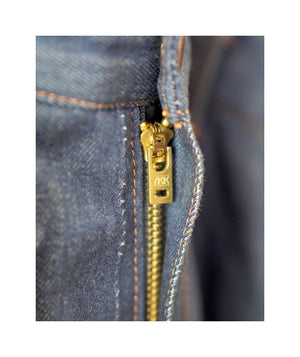 Close up of YKK zipper on sister jeans in classic blue itochu.