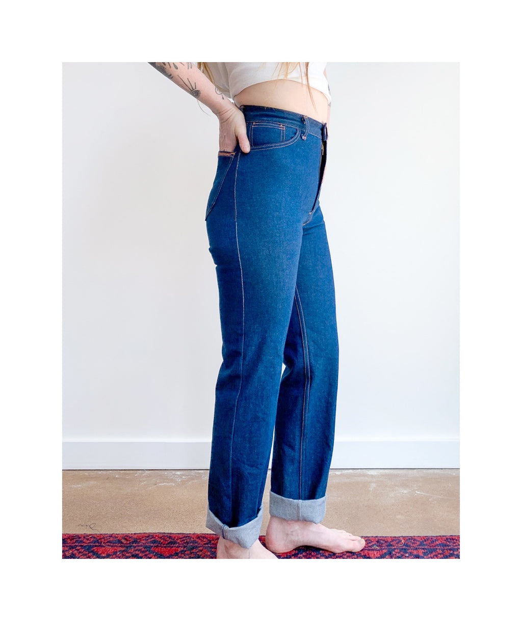 Waist down photo of model wearing sister jeans in classic blue itochu denim facing the right.