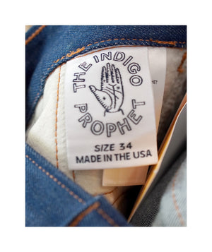 Close up of inner size tag on sister jeans in classic blue itochu.