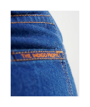 Close up of back tag on back pocket of sister jeans in classic blue itochu.