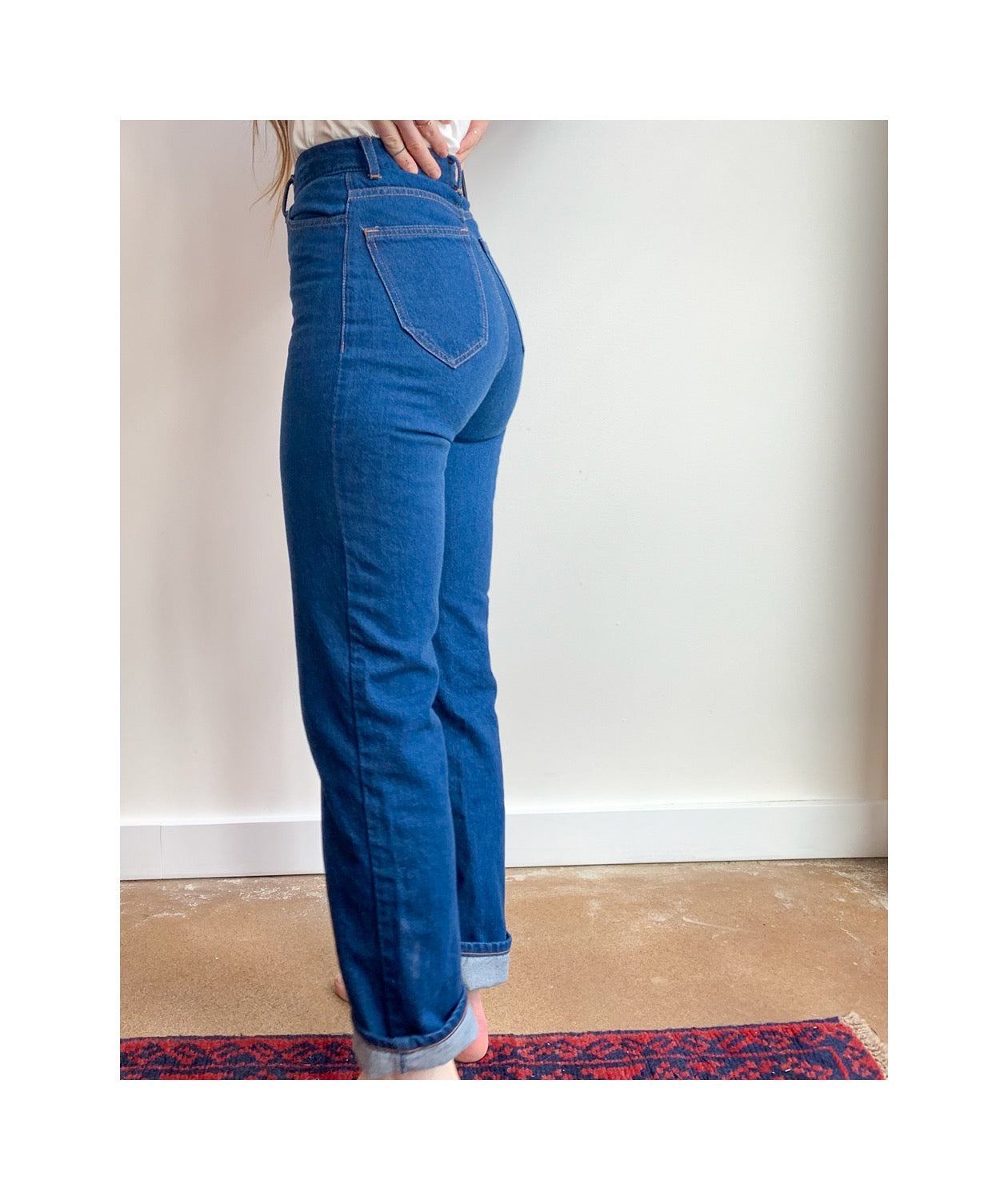 Waist down photo of model wearing sister jeans in classic blue itochu denim facing the left.