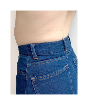 Close up of waistband on model wearing step sister jeans in classic blue itochu from the back.