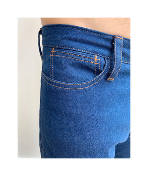 Waist down photo of model wearing mens REVEREND style jeans up close of small coin pocket.
