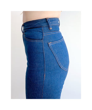 Close up of waist and hips of model wearing sister jeans in classic blue itochu denim facing the left.