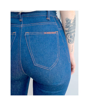Close up of back pocket of model wearing sister jeans in classic blue itochu from back.