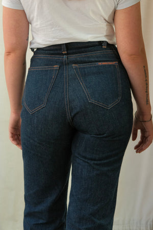 Close up image of model's backside wearing HIGH POPE in classic blue.