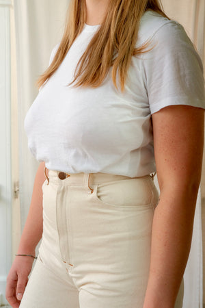 Close up image of model from shoulders to hips wearing HIGH POPE in cream.