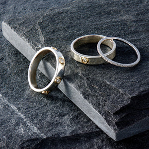 """Liquid Metal"" Sterling Silver with 14K Gold narrow Hammered Band with Seven Diamonds (Size 7)"