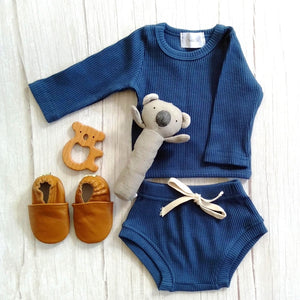 ribbed baby romper, shoes, rattle and teether