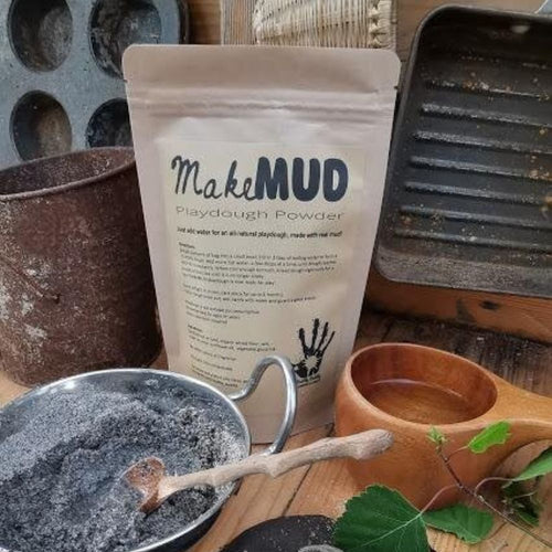 Mud Playdough Powder sachet in a mud kitchen.