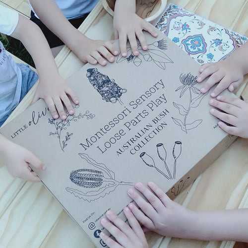 Sensory Nature Box with kids hands on top