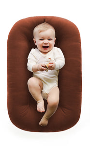 baby-lying-in-baby-nest-lounger