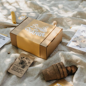 Seed Growing Kit for the Bees in a Kraft box on a rug outside.