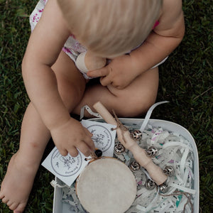 toddler-playing-with-musical-instruments