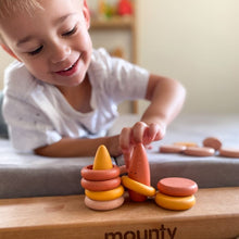 Load image into Gallery viewer, Little boy playing with wooden loose parts.