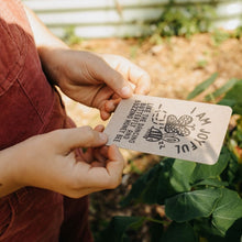 Load image into Gallery viewer, Girl in the garden holding an I am Joyful Affirmation Card.