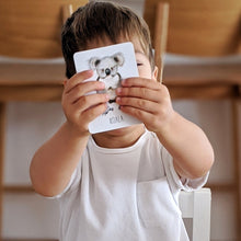 Load image into Gallery viewer, boy-holding-a-koala-card-in-front-of-his-face
