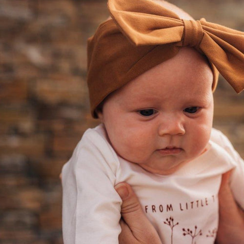 little-baby-girl-wearing-a-brown-headband