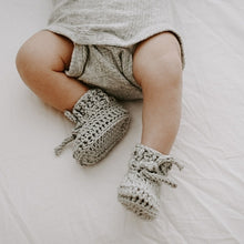 Load image into Gallery viewer, baby-legs-and-torso-wearing-grey-romper-and-booties