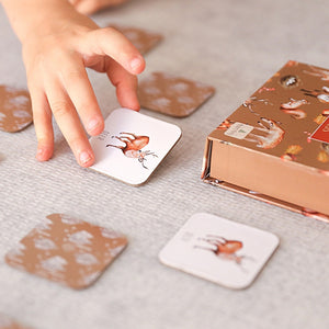 child-turning-over-a-card-in-a-game-of-memory