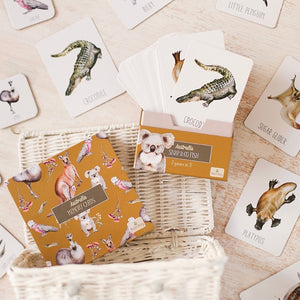 white-basket-on-its-side-spilling-out-a-box-of-australian-animal-cards