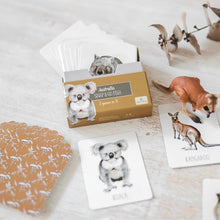Load image into Gallery viewer, box-with-australian-animal-cards-on-its-side-on-a-table-with-a-kangaroo-figure