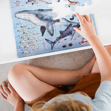 Load image into Gallery viewer, boy-sitting-at-table-completing-an-ocean-puzzle