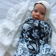 Load image into Gallery viewer, baby-in-bonnet-swaddled-in-black-and-white-wrap