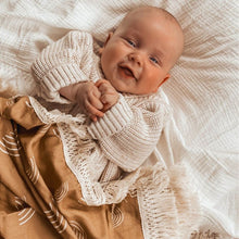Load image into Gallery viewer, smiling baby laying under a rainbow blanket