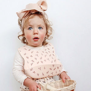 toddler-girl-wearing-a-silicone-bib