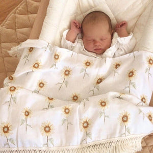 baby asleep under sunflower wrap