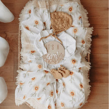 Load image into Gallery viewer, baby flat lay with milestone disc and sunflower wrap