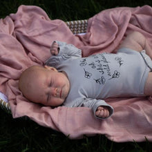 Load image into Gallery viewer, baby-girl-in-wildflower-fluttersuit-lying-on-a-pink-blanket-in-a-basket
