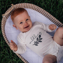 Load image into Gallery viewer, ginger-haired-baby-lying-outside-on-grass-in-baby-basket