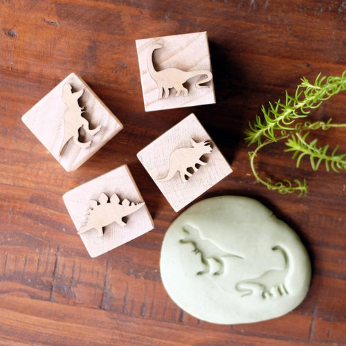 playdough-and-wooden-playdough-stampers-on-a-table