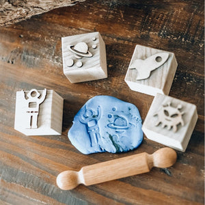 playdough-a-rolling-pin-and-space-playdough-stampers-on-a-table