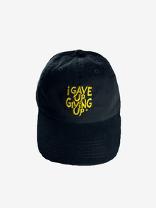 """I Gave Up Giving Up®"" Hat (Black/Yellow)"