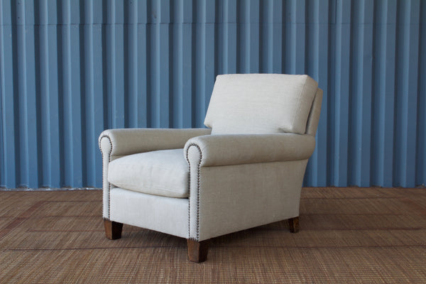 The Vista Upholstered Armchair, designed by Hollywood at Home founder Peter Dunham, is an updated take on the classic club chair. It's made by hand in Los Angeles with a rounded arm with brass nailhead detail and a deep, comfortable seat.