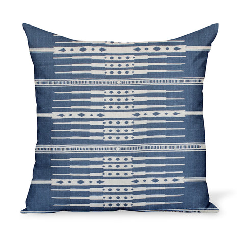 A decorative cushion made from Peter Dunham Textiles' linen print Tangiers in Indigo blue. A tribal yet pretty fabric available as pillows in a variety of sizes!