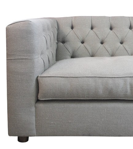 Our beautiful Wormley Sofa was inspired by a 1950s Edward Wormley Sofa, featuring button-tufted details along the back and self-welt seat cushions. It's handmade in Los Angeles with COM (customer's own material).