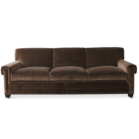 A customizable sofa with nailhead detail, designed by Peter Dunham for hollywood at Home, handmade in Los Angeles.