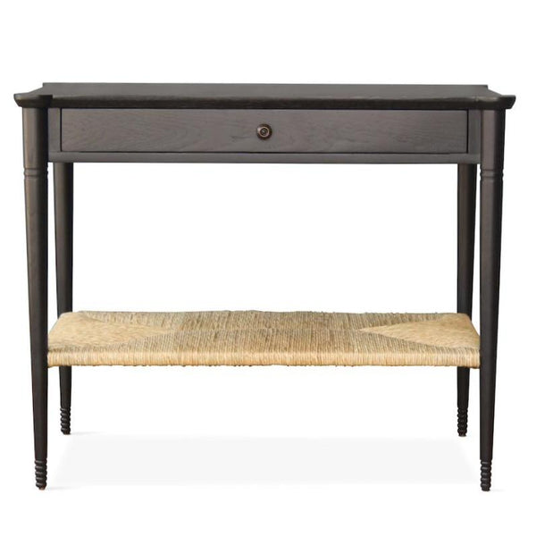 Our Holden End Table, designed by Peter Dunham for Hollywood at Home, is hand turned from white oak with a natural rush shelf. Perfect as a bedside table, nightstand, or side table.