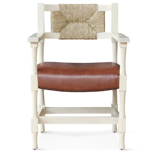 This New York Athletic Club dining side chair is a 40s twist on an arts & crafts classic: a re-edition by Peter Dunham for Hollywood at Home of a chair from the Downtown New York Athletic Club. Remarkably comfortable, the chair is crafted from hand-turned solid oak and handwoven rush.