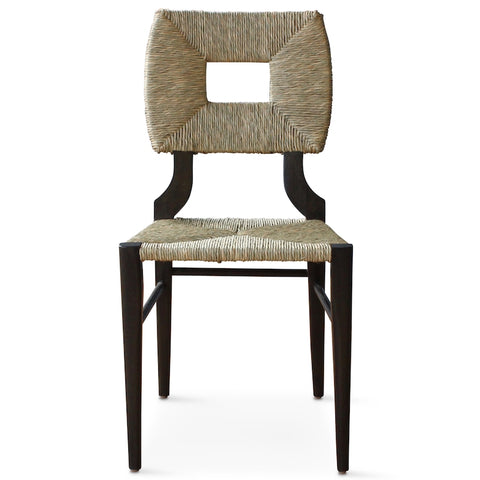 A dining side chair of our iconic handmade How to Marry A Millionaire chair, a reedition of a chair our founder Peter Dunham bought at a Hollywood memorabilia auction and attributed to legendary designer T. H. Robsjohn-Gibbings.