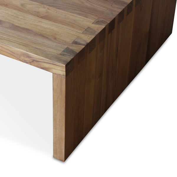 The Dovetail Coffee Table is a large, sturdy table in all teak with a chic, over-sized joinery detail designed by Hollywood at Home founder Peter Dunham. This is part of Hollywood at Home's first-ever in-stock furniture collection. Shipping & handling typically takes 2 weeks from order confirmation. Shipping for the Dovetail Coffee Table is $150 and calculated at checkout.