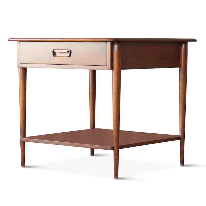 Our Walnut Two-Tiered End Table was inspired by Mid-Century end tables Hollywood at Home's founder Peter Dunham found in France and features detailed butterfly joints and tapered legs. A drawer for storage and shelf for books or magazines makes this perfectly functional for a bedside table.
