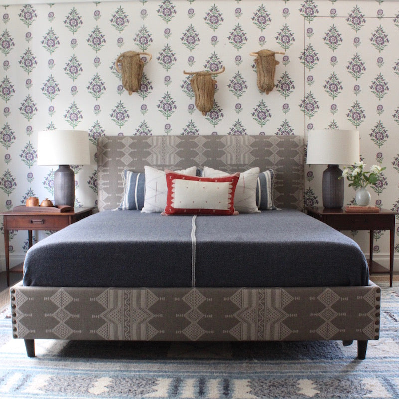 Our Upholstered Bed is made to order in Los Angeles and a wonderful way to incorporate a favorite pattern, color or texture into the bedroom. The bed, designed by Hollywood at Home founder Peter Dunham, is made with Customer's Own Material (COM), brass nailhead detailing and dark walnut legs. Available as a Queen, King, and California King.