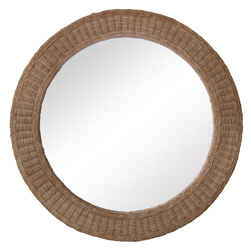 A handwoven wicker framed round mirror, available in custom sizes. Designed by Peter Dunham for Hollywood at Home.