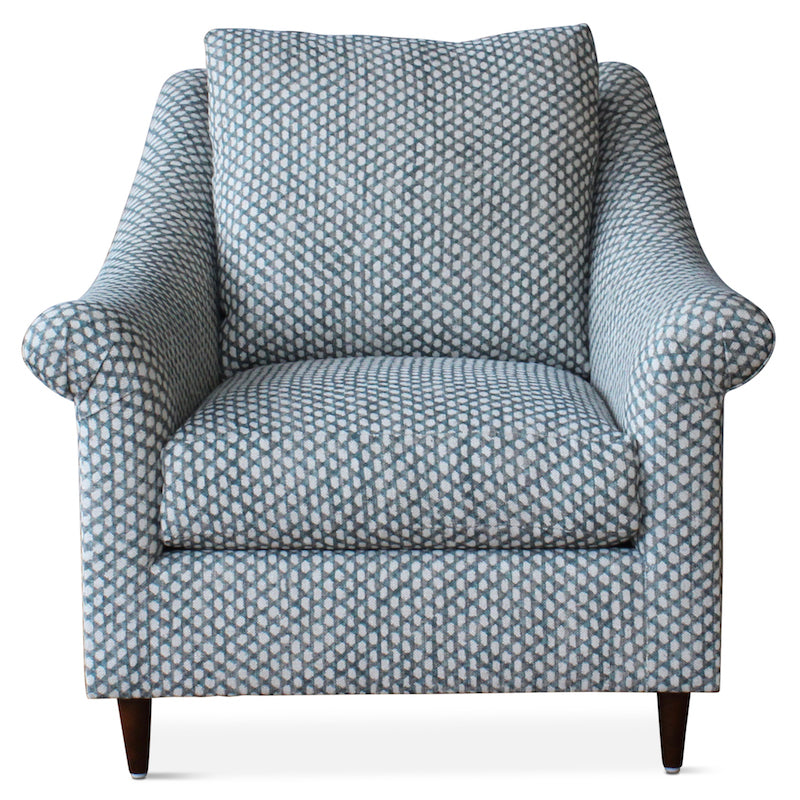 The Melrose Armchair, designed by Hollywood at Home founder Peter Dunham, is inviting and comfortable, featuring loose cushions, a turned arm, and tapered legs.