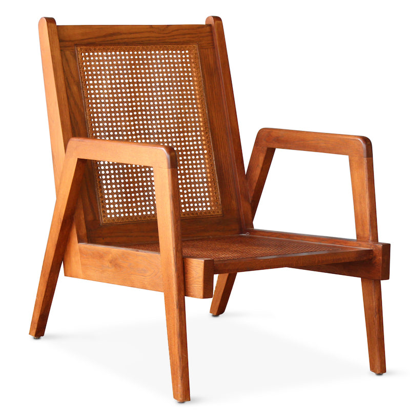 Our New Chandigarh Armchair is a nod to the original Chandigarh, inspired by Pierre Jeannette's iconic chair. The New Chandigarh Armchair, hand-crafted in Los Angeles with a solid wood frame, has an updated arm and added details along the caned seat and back.